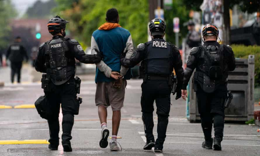Police detain a person as city crews dismantle Chop in Seattle, Washington, on 1 July.