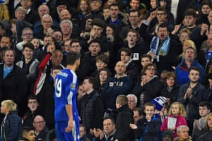 Chelsea fans gesture towards Diego Costa as he is substituted.