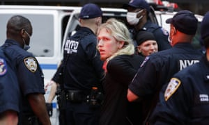 New York Police officers arrest protesters as they rally.