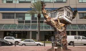 An artwork called Scrap House by artist Sally Heller commemorates hurricane Katrina across the street from the New Orleans Ernest N Morial Convention Center.