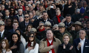 Donald Trump supporters stand for the national anthem during a 'Make America Great Again' concert in Washington last month.