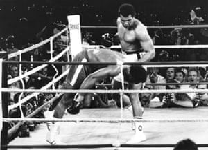Muhammad Ali watches George Foreman head for the canvas
