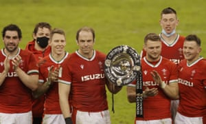 Captain Alun Wyn Jones of Wales holds the Triple Crown trophy.