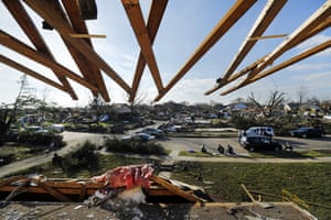 <strong>Garland, US</strong><br>Roof rafters protrude over an upstairs bedroom that was torn away in a tornado.