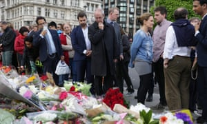 Archbishop of Canterbury Justin Welby (C) pauses with members of the public at memorial to Jo Cox in Parliament Square.