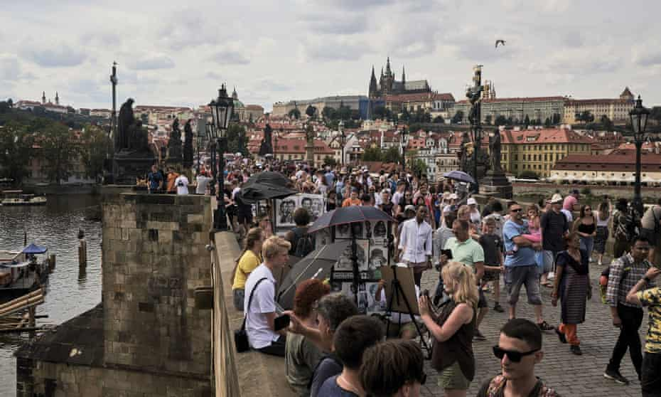 Tourists on Prague's Charles Bridge this summer. The city is now Europe's fifth most visited destination
