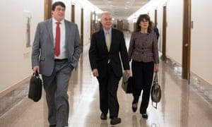Tom Price walks to a meeting with Bernie Sanders in Washington on Tuesday.