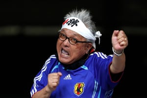 A supporter of Japan cheers his team.