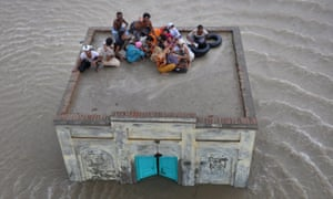 A family takes refuge in the aftermath of floods in Pakistan's Punjab province.