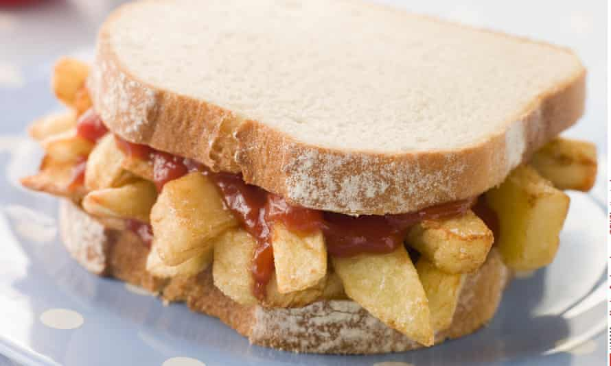 A chip butty made with white sliced bread.