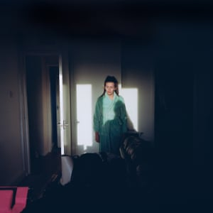 Courtney in her Living Room / In This Place (2016-17) It was high summer, or as high as it ever gets in Scotland. Standing on the balcony of Kellie's third floor flat, I looked back in. Back in at Courtney and her reality. The 'place' becomes not only on the outside, in the environment, but also on the inside, in your own head.