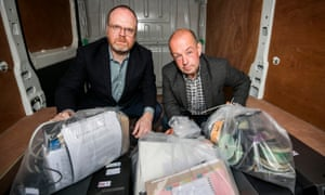 Trevor Birney and Barry McCaffrey in Belfast with journalistic material unlawfully seized by police