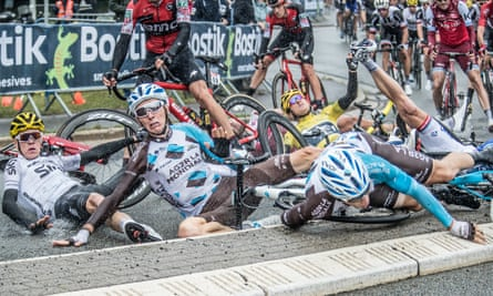 Yellow jersey Geraint Thomas,  Chris Froome, Richie Porte and Romain Bardet are among the riders who get caught up in the crash in the rain at a roundabout on the Tour's second stage to Liège