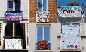 Banners hanging at apartment windows in Paris.