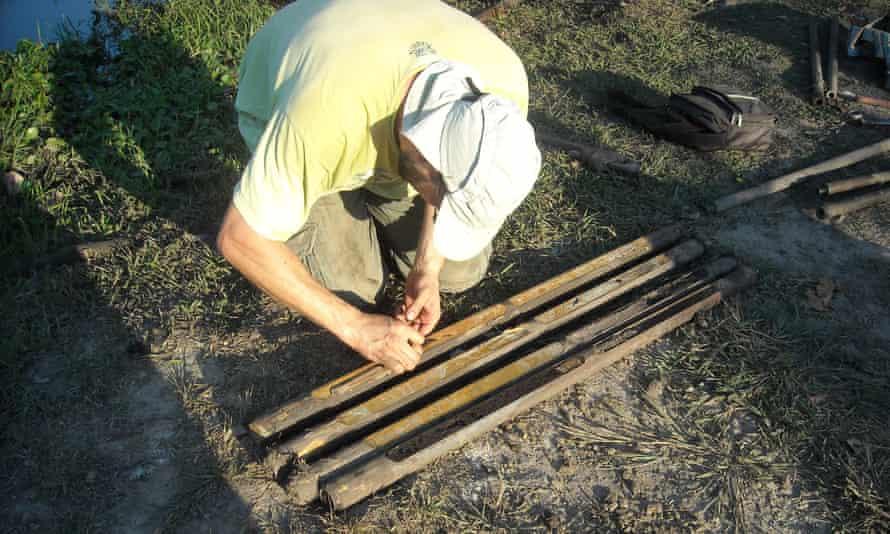 Prof Umberto Lombardo sampling sediment cores in the Llanos de Moxos savannah.