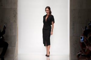 Victoria Beckham on the catwalk at the end of her show