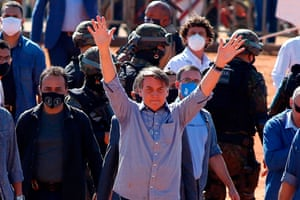 5 June: Bolsonaro waves to supporters during the inauguration of a field hospital in Águas Lindas, Goiás.