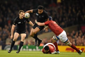 Julian Savea is tackled by Bernard Le Roux.