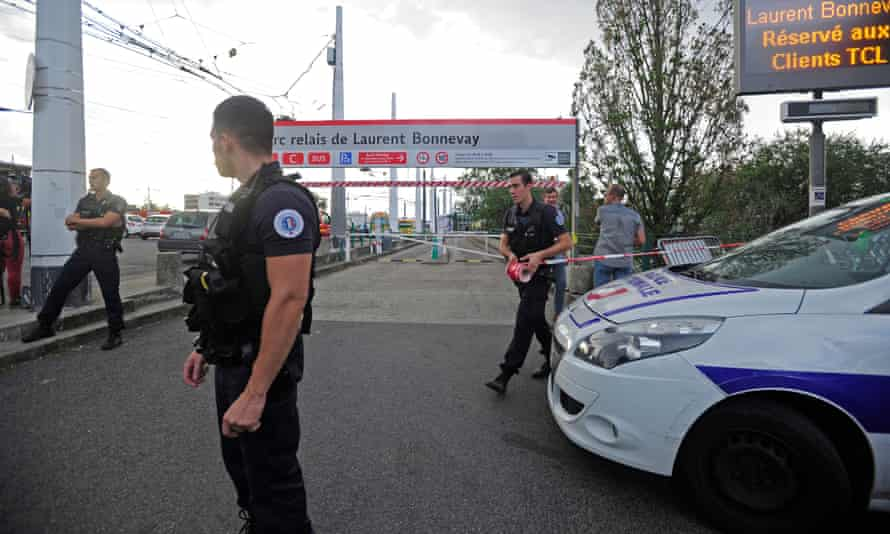 A police officer stands guard in Villeurbanne