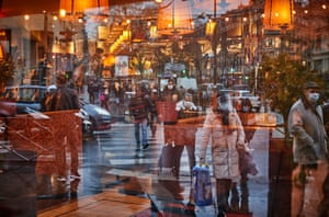 Paris, France Shoppers are reflected in a closed restaurant window as the government continues to try to contain Covid numbers and speed up the country's vaccine rollout