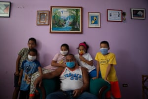 A group of children pose for a portrait in an apartment at La Lira, a neighbourhood in the Petare area of Caracas, Venezuela, during the Covid-19 outbreak on 25 March