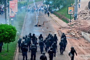 Riot police fire tear gas to disperse supporters of the Libertad y Refundacion (LIBRE) party in Tegucigalpa, on 24 October 2019, during a protest to demand the resignation of Honduran president Juan Orlando Hernández for his alleged links to drug trafficking