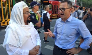 Green leader Richard Di Natale attends anti-Trump protests in Melbourne on Friday.