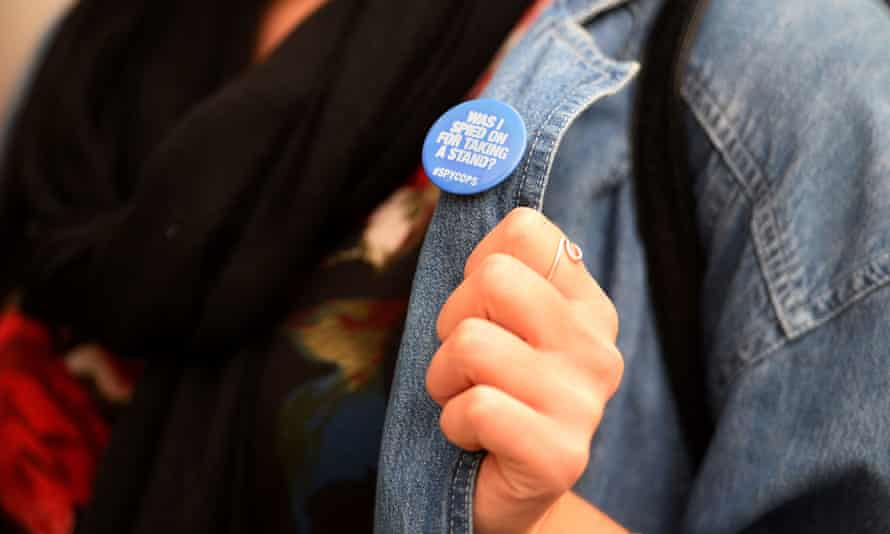 Protester wearing a badge that says: Was I spied on for taking a stand?