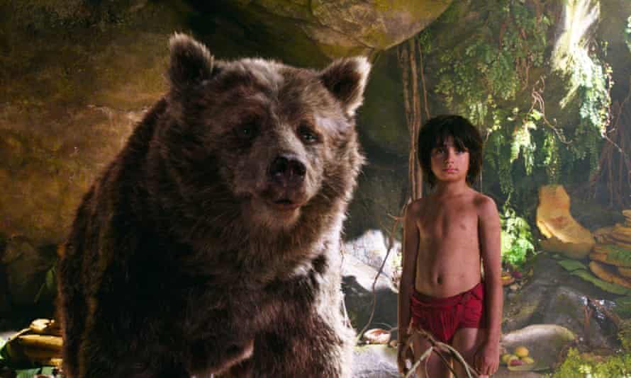 King of the swingers … Neel Sethi as Mowgli with and Baloo the bear, voiced by Bill Murray, in The Jungle Book.