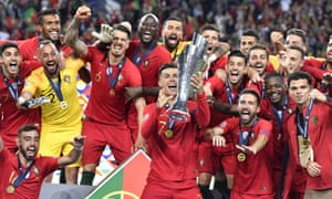 Cristiano Ronaldo lifts up the trophy as the jubilant Portugal players party in front of their home fans after beating Netherlands to win the the Nations League.