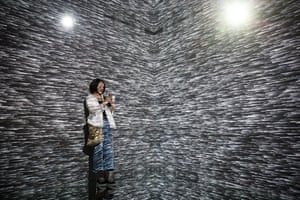 Beijing, China A visitor is bathed in abstract light at The Future of Today exhibition at the Today Art Museum
