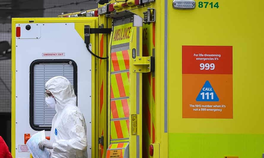 A paramedic wearing personal protective equipment (PPE) exits an ambulance outside St Thomas' hospital in Westminster, London.
