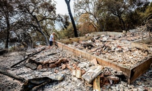 Jim Wilson looks at the remains of his house for the first time after it burned down.