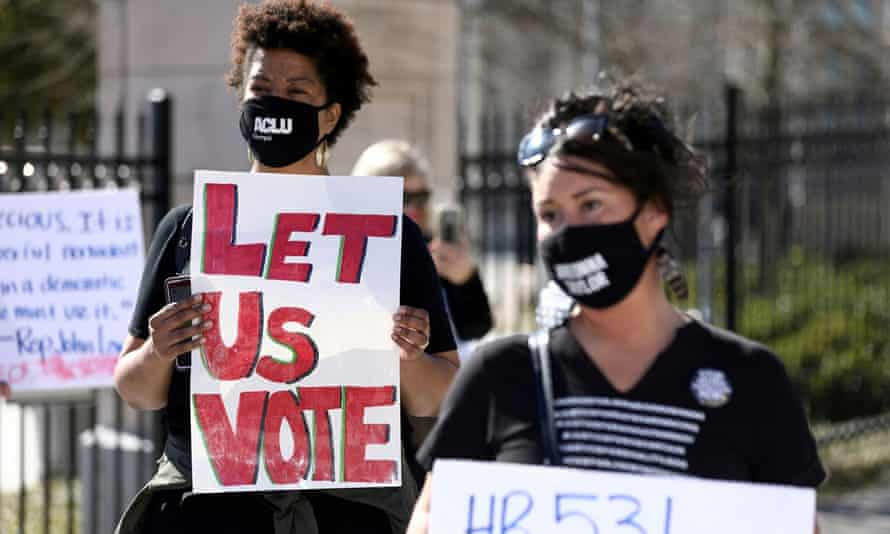 Demonstrators protest against voting restrictions in Atlanta, Georgia, on 4 March.