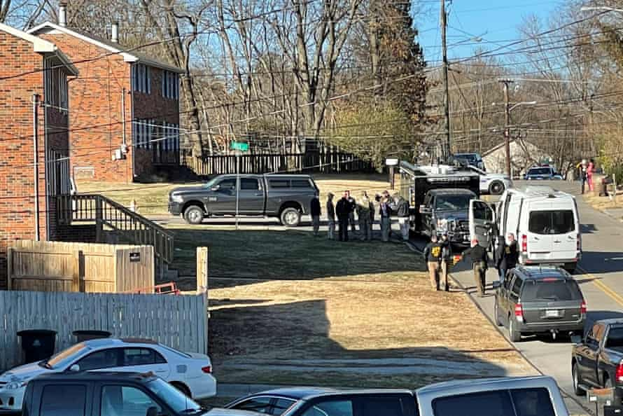 Law enforcement officers gather outside a duplex house in Antioch, Tennessee, on 26 December.
