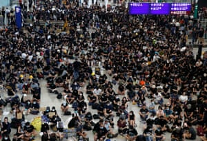 Hong Kong airport staff stage protest against Yuen Long attack | World news | The Guardian
