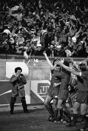 Liverpool players celebrate in front of their fans after Alan Kennedy, centre, had scored the first goal
