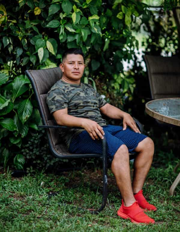 Elbin Sales Pérez, a seasonal farmworker and landscaper, picks palmetto berries when there is no other agricultural work. Despite the risks involved, it provides an essential part of his annual income.