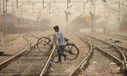A commuter crosses railway tracks in Jalandhar, Punjab.
