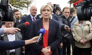 Marine Le Pen visiting a pig farm in Brittany, March 2017