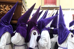 People in scary pointed hoods and white robes