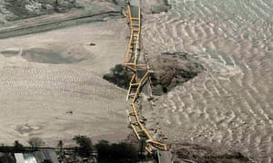 A bridge collapsed at the mouth of the bay in Palu.