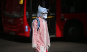 BRITAIN-HEALTH-VIRUS<br>A person, wearing a face mask, goggles and an anorak as a precautionary measure against COVID-19, crosses an almost empty road near Waterloo Station in central London on April 8, 2020, as life in Britain continues during the nationwide lockdown to combat the novel coronavirus pandemic. - Britain's Prime Minister Boris Johnson began a third day in intensive care on April 8 battling the coronavirus, which has struck at the heart of the British government, infected more than 55,000 people across the country and killed nearly 6,200. (Photo by Isabel Infantes / AFP) (Photo by ISABEL INFANTES/AFP via Getty Images)