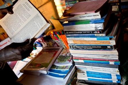 Juma Ali reads a book in his bookshop.