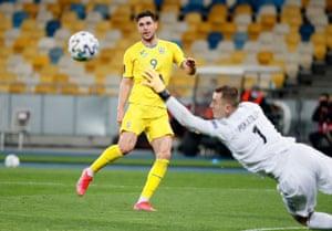 Ukraine's Roman Yaremchuk scores their first goal.