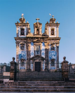 Rhapsody in blue. Around 11,000 azulejo tiles cover the outside of the Igreja de Santo Ildefonso. The church was built in the 18th century but the tiles, painted by the artist Jorge Colaço, were only added in 1932. They are now in dire need of renovation.