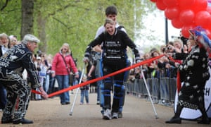 Claire Lomas crosses the London Marathon finish line in an Israeli-made ReWalk suit.