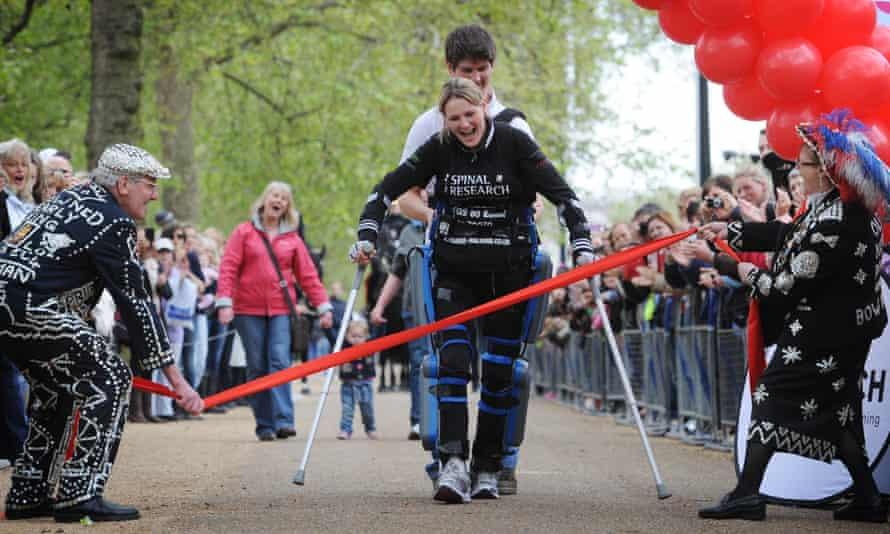 Claire Lomas crosses the London Marathon finish line in an Israeli-made ReWalk suit.