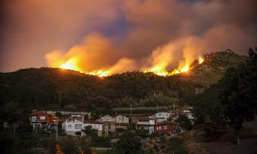 A forest fire near a village in Galicia, north-western Spain, last month.