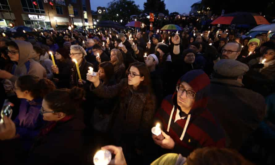 People gather for a vigil in the Squirrel Hill neighborhood.